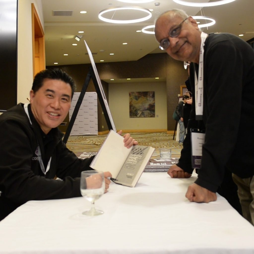 Ray Wang signing a complimentary copy of his book at the opening reception at LicensingLive!.